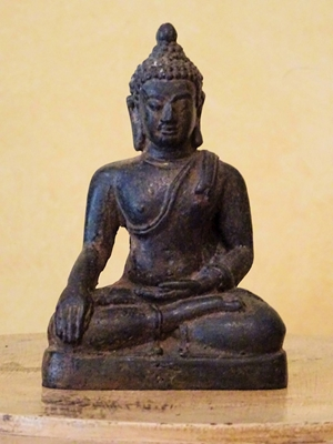 Seated Bronze statue of Buddha from Sri Lanka with his right hand in Bhumispara and left hand in dhyana while wearing monastic robes (utterasangha)