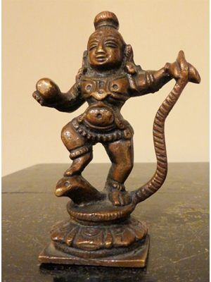 "Kaliya Krishna at his child form with butter in his right hand subduing the evil serpent of Jamuna, South Indian bronze H 3.3"", ca 19th century"