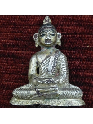 A charming miniature Srilankan Buddha in seated position and wearing his robes (utterasanga) with overlying shawl (sanghati)