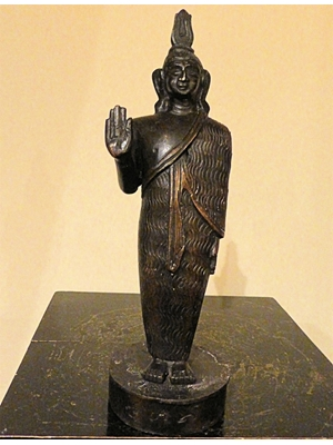 An unusual bronze statue of standing Buddha from Sri Lanka, early 20th century, Weighs 2' 1/2 pounds. 9' 1/2 inches tall.