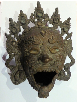 Bahirava bronze incense mask, from Nepal. A vengeful form of Shiva with snakes as his earrings 8.5 X 6, 17th  18th cent