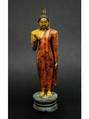 Standing Kandyan Buddha carved from wood and magnificently painted on colours. The statue bears all the traditional features of Buddhist sculpture from Sri Lanka (former Ceylon). Ca 18th century