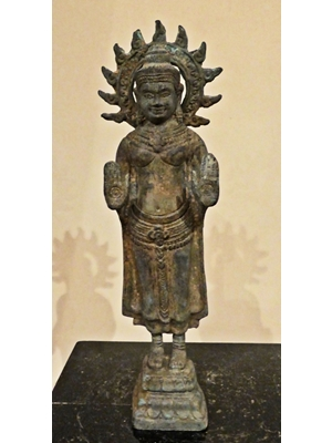 Khmer standing Buddha with his palms outstretched in abhaya mudra position while standing on a double lotus square base. The details of his jewellery around his neck and waist are finely cast, 12th to 14th century Buddha, bronz, H 12,