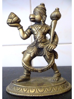 Hanuman (Hahnuman), a south Indian brass/bronze figure depicting a scene from the Hinu Epic Ramyana. 13 cm tall, ca early 20th century.