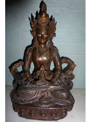 A Tibetan bronze of Bodhisattva Avaloketsvara seated on a double motiff lotus base in vajrasana SOLD